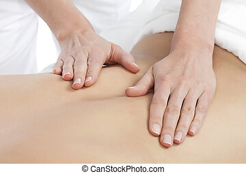 back massage at spa - Image of a Masseuse giving a relaxing...