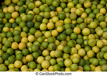 Green and yellow Limes at fruit mar - Fresh green and yellow...