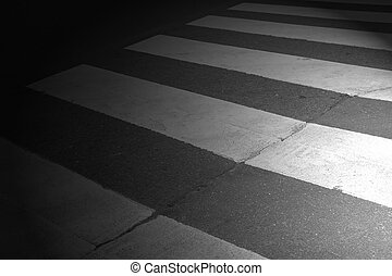 night crosswalk, enlightened by lighthouses