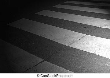 night crosswalk, enlightened by lighthouses