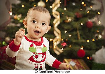 Infant Mixed Race Baby Enjoying Christmas Morning Near The...