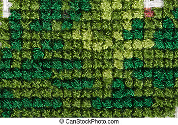 Cross stitching close-up. Dark green