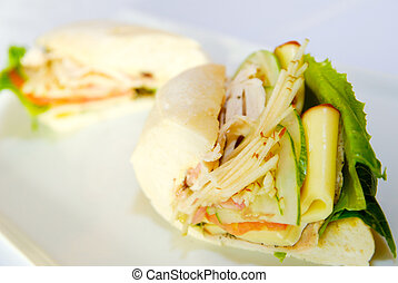 Sandwich with salmon and cucumbers on white bread