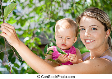 Young mother playing with her baby