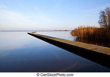 long wooden pier over lake