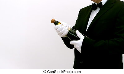 Man opening a bottle of champagne against a white background