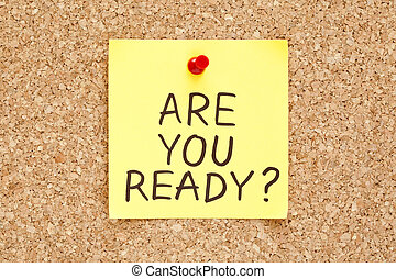 Are You Ready, written on an yellow sticky note on a cork...