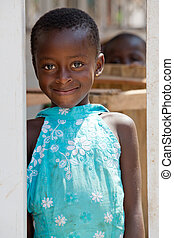 Little sister looks on - Pretty girl in turquoise dress in...
