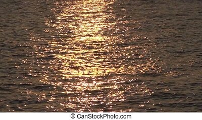 sea waves with light reflections at