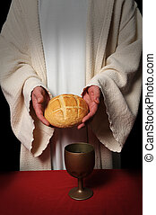 Communion - Jesus hands holding the bread at the Communion...