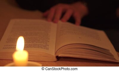 Book Reading With Candle 002 - Woman reading a book with...