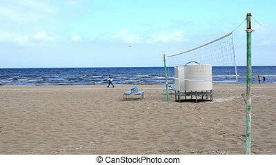 volleyball net people sea