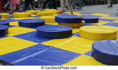 kid play checker big - Huge colorful checker game figures...