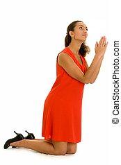 woman prays - Pray. The beautiful woman prays, kneeling on a...