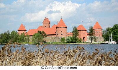 People rest Trakai castle