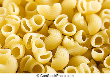 pasta - raw macaroni pasta background close up shoot