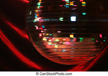 spinning disco ball - spinning mirror disco ball giving off...