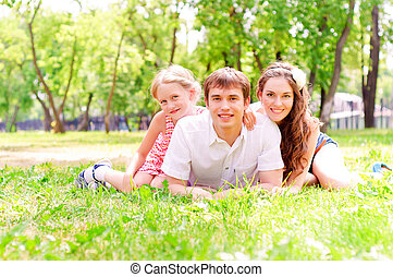 Family lying in the park