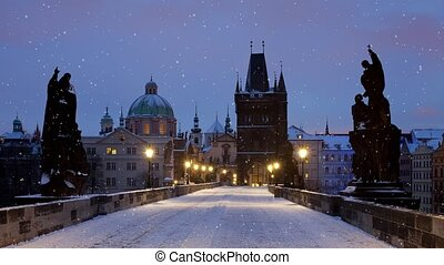 Charles Bridge, Prague - Falling snow in Prague (Charles...