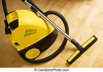 vacuum cleaner on a wooden floor