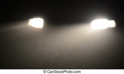 Fog in the headlights of car