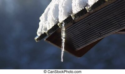 icicle on a roof - dropping icicle on a roof
