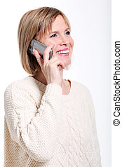 Middle aged woman talking by cellphone smiling - Caucasian...