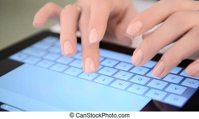 Typing on virtual keyboard. Woman hands and touch screen