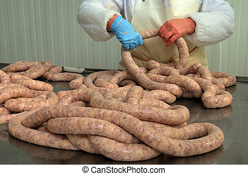 close-up making sausages automatic process - Meat plant...