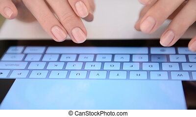 Woman typing on virtual keyboard