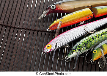 fishing lures - Illustration of fishing lures on a wooden...