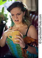 Young Woman Drinking Coffee - Young woman drinking coffee in...