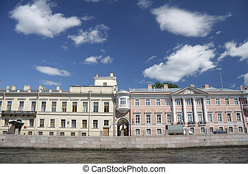 Two coloured building over river in St.Petersburg