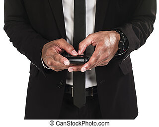 front view mid section of business man text messaging -...