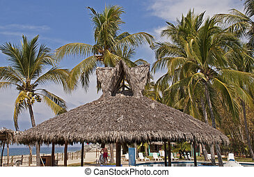 Resort palapa with palm trees - Tropical resort palapa with...