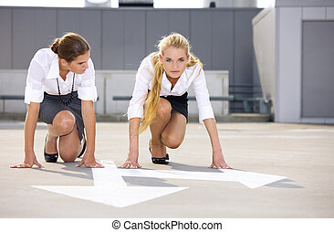 start - arrow pointer and two confident businesswomen ready...