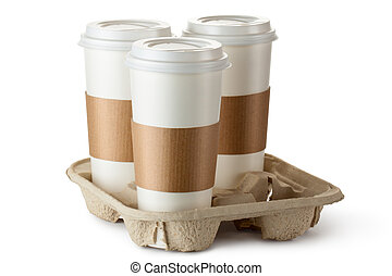 Three take-out coffee in holder Isolated on a white
