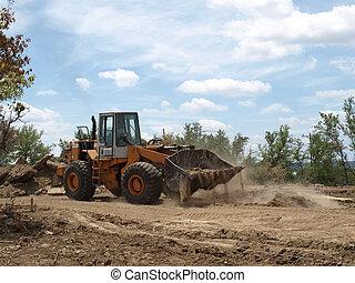 Moving Dirt - Bulldozer moving dirt on jobsite