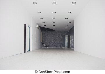 Long white corridor with the door