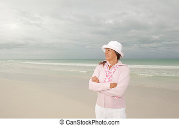 Confident happy mature woman beach vacation - Portrait...