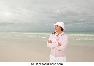 Confident happy mature woman beach vacation - Portrait...