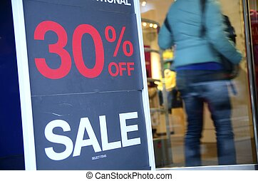 On Sale sign at the store front concept of discount shopping
