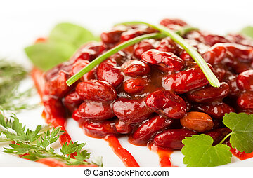 Red beans in tomato sauce on a dish. Closeup shot with...