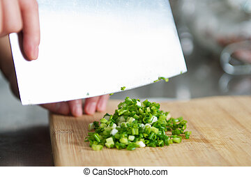 Cutting Scallion - Cutting scallion and preparing the food
