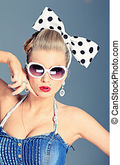 expressive - Beautiful young woman with pin-up make-up and...