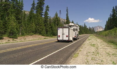 Camper on mountain road - Camper driving on a mountain road