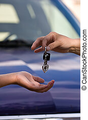 handing off - hands and car keys woman heart on key chain