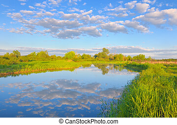 Rural landscape with Narew river and Stratocumulus clouds