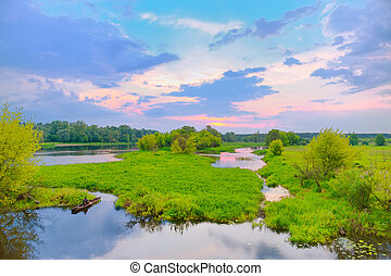 Beautiful morning landscape with boat visible on the Narew...