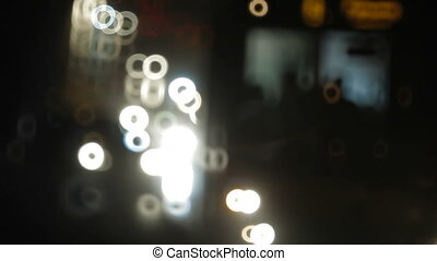 Night traffic on the road - Reflections of car headlights....